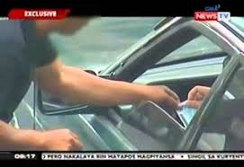 Photo credits from GMA News TV - Alleged Kotong caught in camera aired in mainstream Free TV.